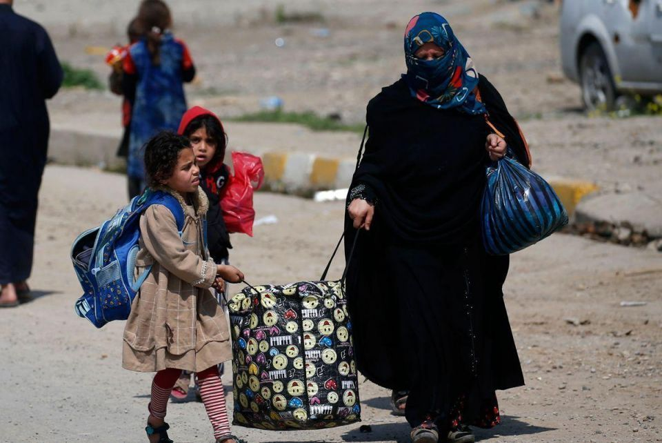 In pictures: Rush hour on Mosul's 'displacement highway'