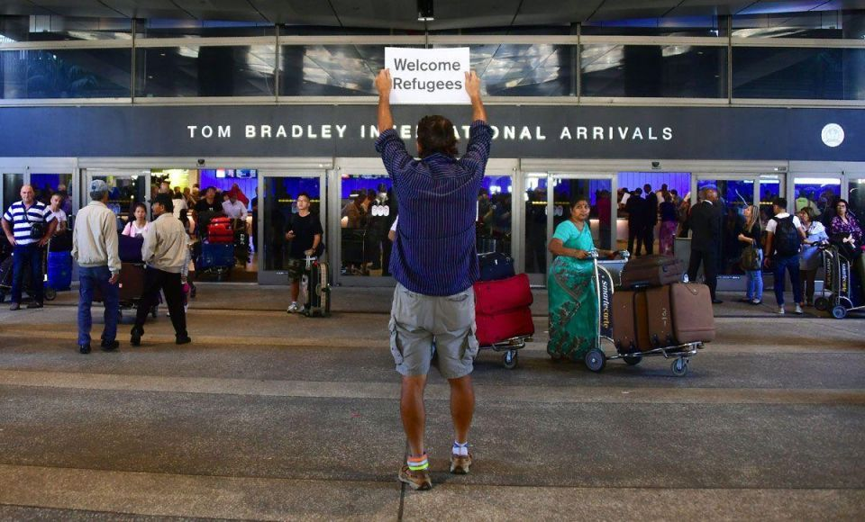 In pictures: Trump travel ban goes into effect