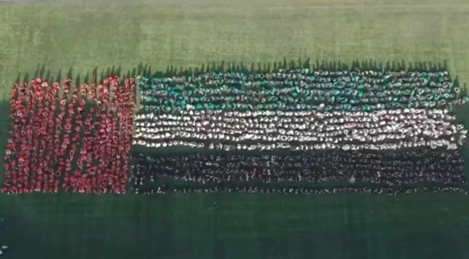 GEMS students form world's largest human waving flag