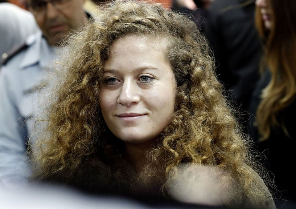 Palestinian teenager Ahed Tamimi jailed for slapping soldiers leaves prison