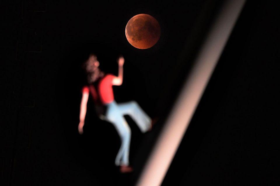Gallery: Century's longest 'blood moon' lunar eclipse dazzled sky gazers across the globe