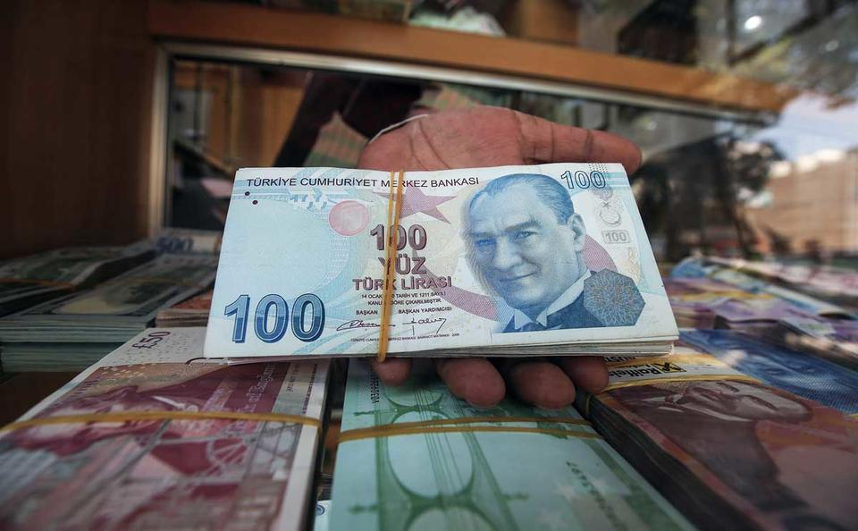 In pictures: Turkish lira continues to slide