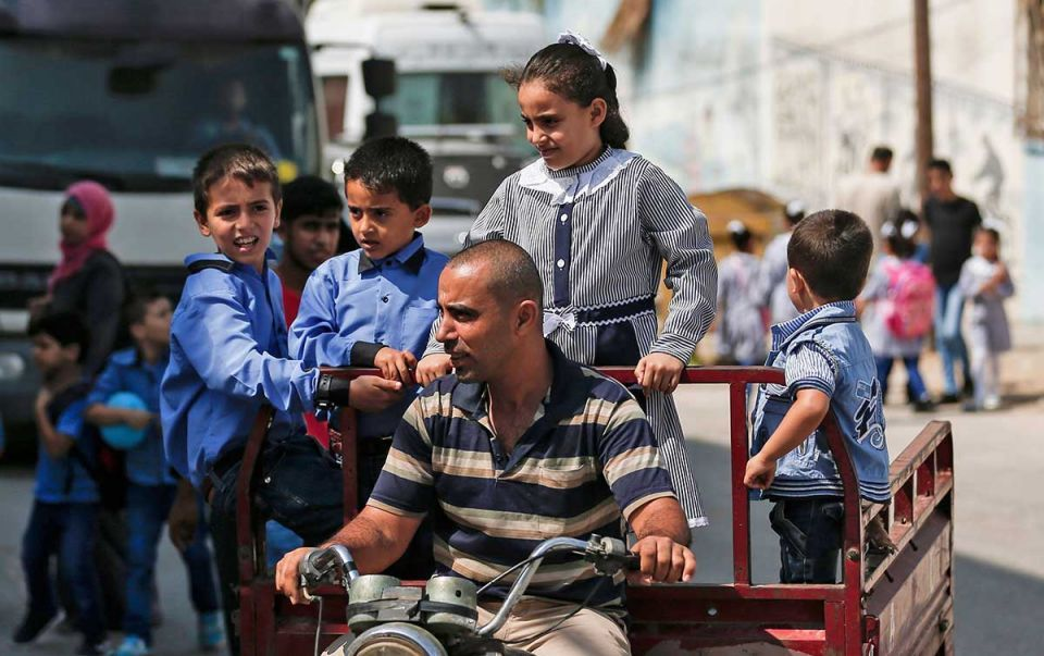 Gallery: New school year starts in occupied West Bank and Gaza City