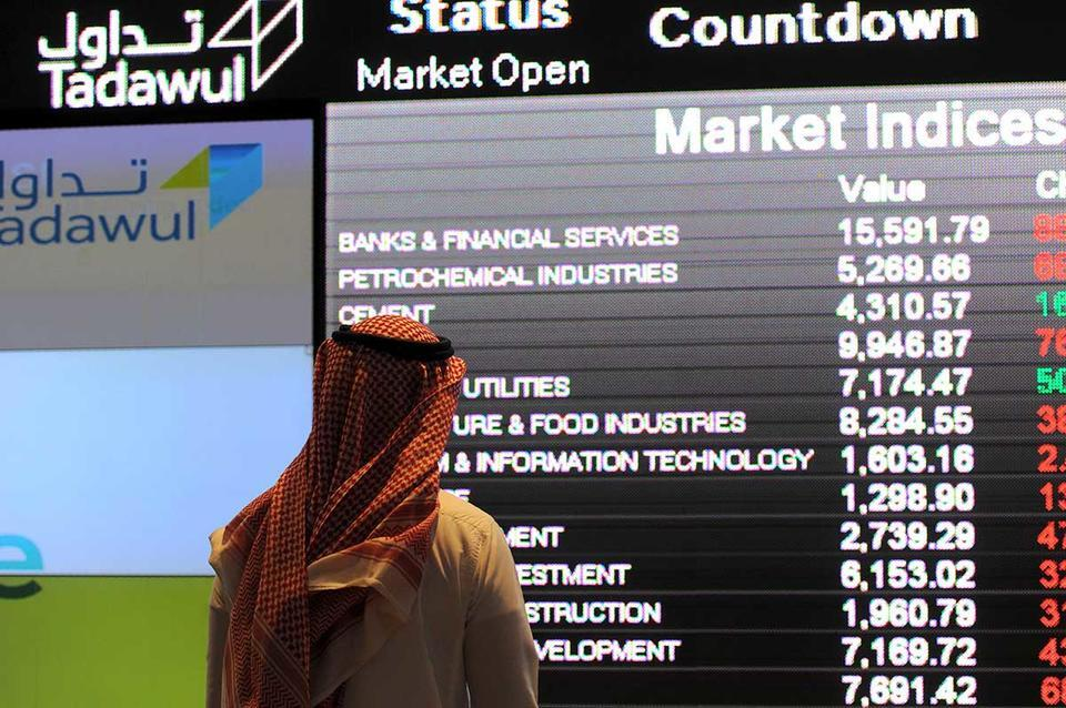 Saudi bank stocks dip after Islamic levy settlement
