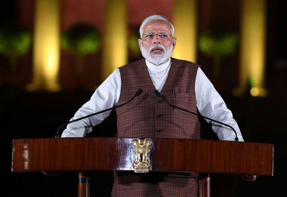India to further ease tax rules to boost investment, Modi says