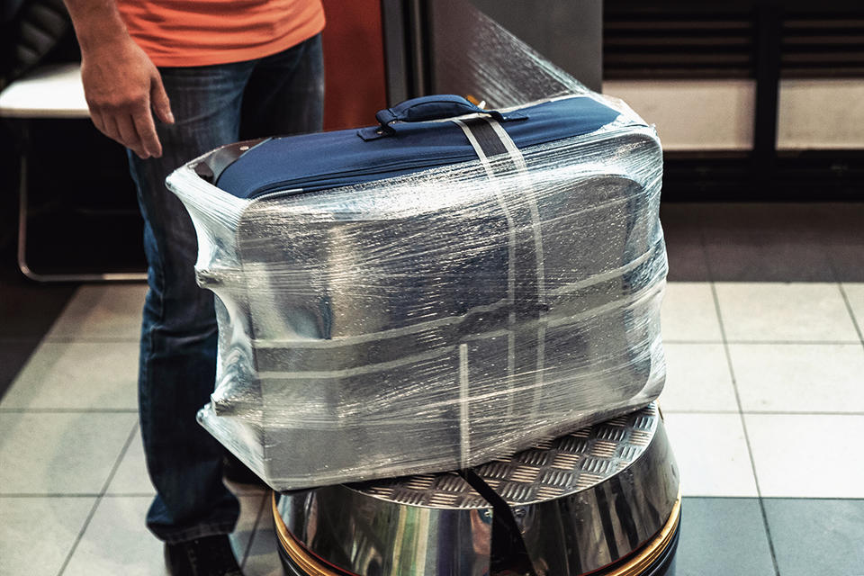 Pakistanis angered by new airport baggage-wrapping policy