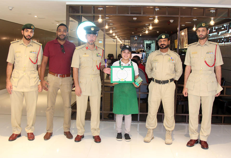 Dubai Police honours Starbucks employee for returning bag with cash, cheques