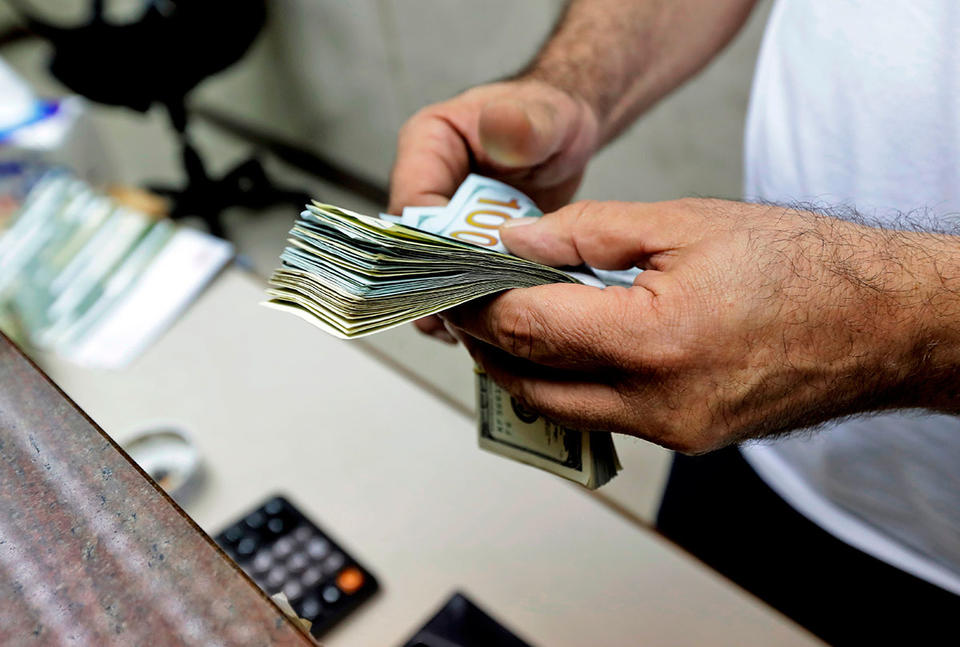 Lebanon caps dollar exchange rate in bid to curb the local currency's devaluation