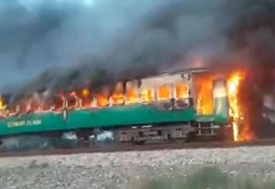 At least 65 killed in Pakistan passenger train fire