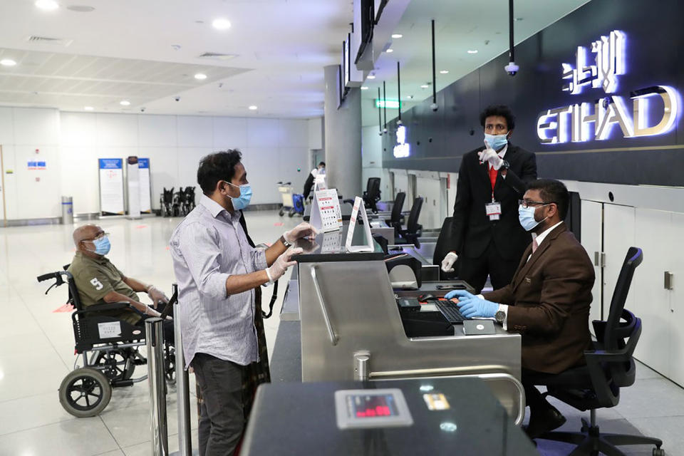 In pictures: India begins repatriating stranded workers from Abu Dhabi and Dubai