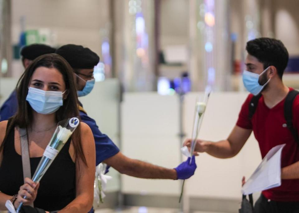 In pictures: Dubai airport welcomes Lebanese travelers with white roses